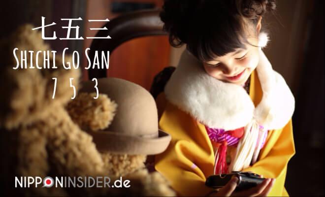 japanischer Feiertag am 15. November: Shichi go san - 753. Nild: Mädchen im Kimono lächelt in ihre Kamera | Nipponinsider