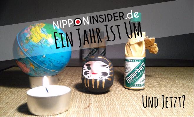 Ein Jahr ist um. Und jetzt? Bild: eine Geburtstagskerze vor einer Weltkugel, ein Daruma und eine Flasche Underberg | Nipponinisider Japanblog