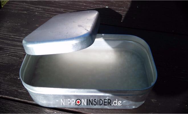 Reis beim Waschen in einer Dose | Nipponinsider