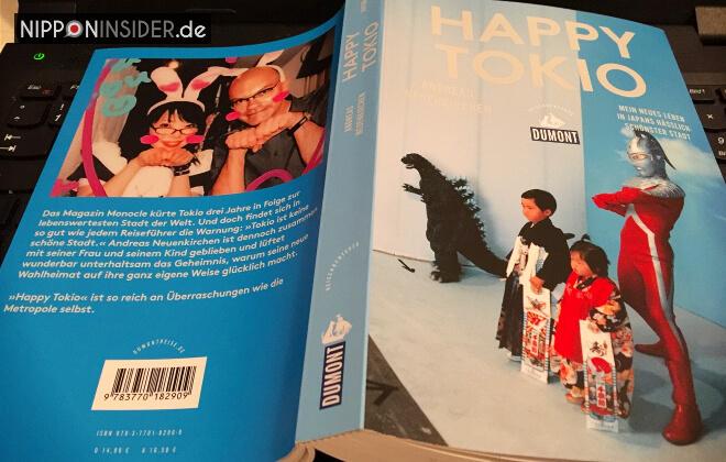 Buchvorstellung: Happy Tokio von Andreas Neuenkirchen. Bild des aufgeschlagenen Buches mit Titel und Rücken | Nipponinsider